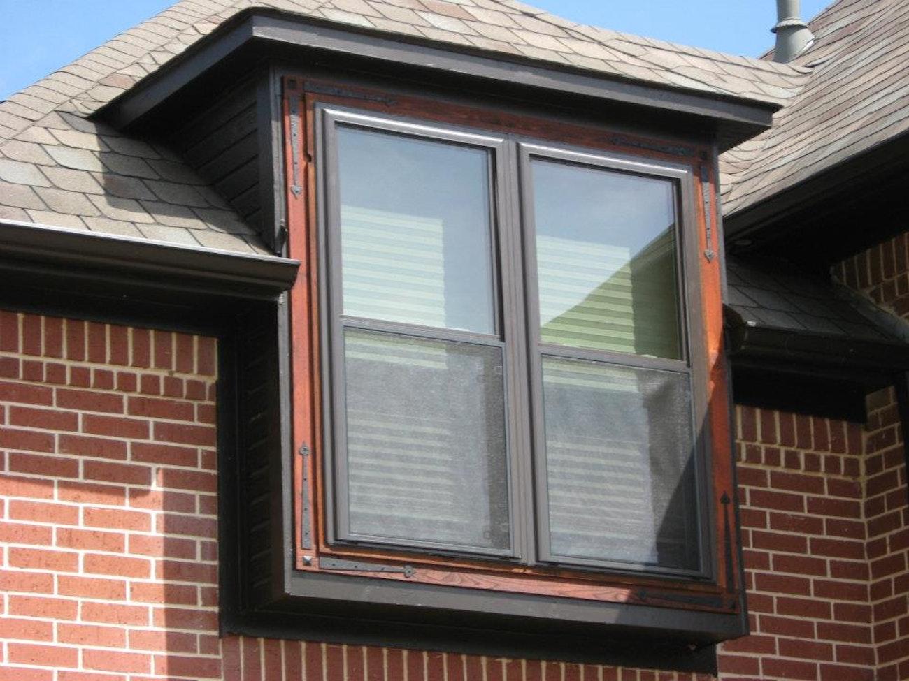 bronze-single-hung-twin-windows-with-red-brick
