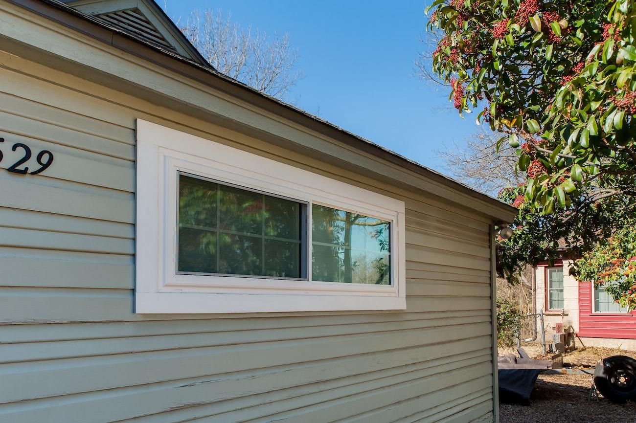 brennan-traditions-white-sliding-window-in-siding