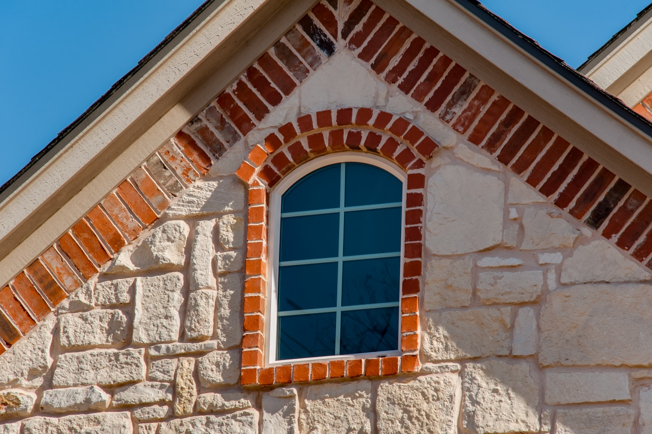 brennan-traditions-window-specialty-stone-and-brick