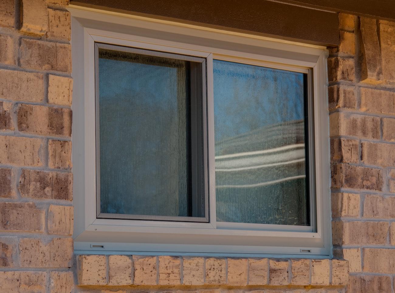 brennan-traditions-tan-sliding-window