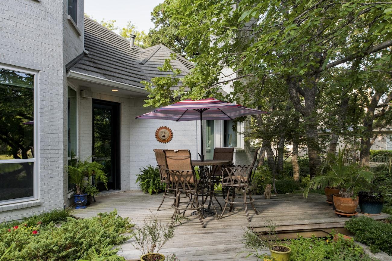 patio-view-of-black-hinged-provia-doors